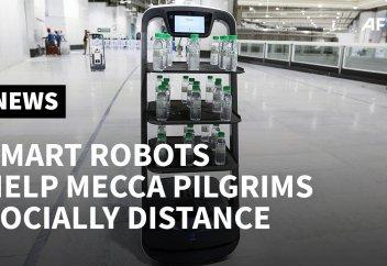 Разные: Из-за пандемии в Мекке священную воду начали раздавать роботы